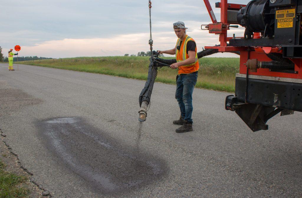 asphalt tack coat for asphalt oil being applied