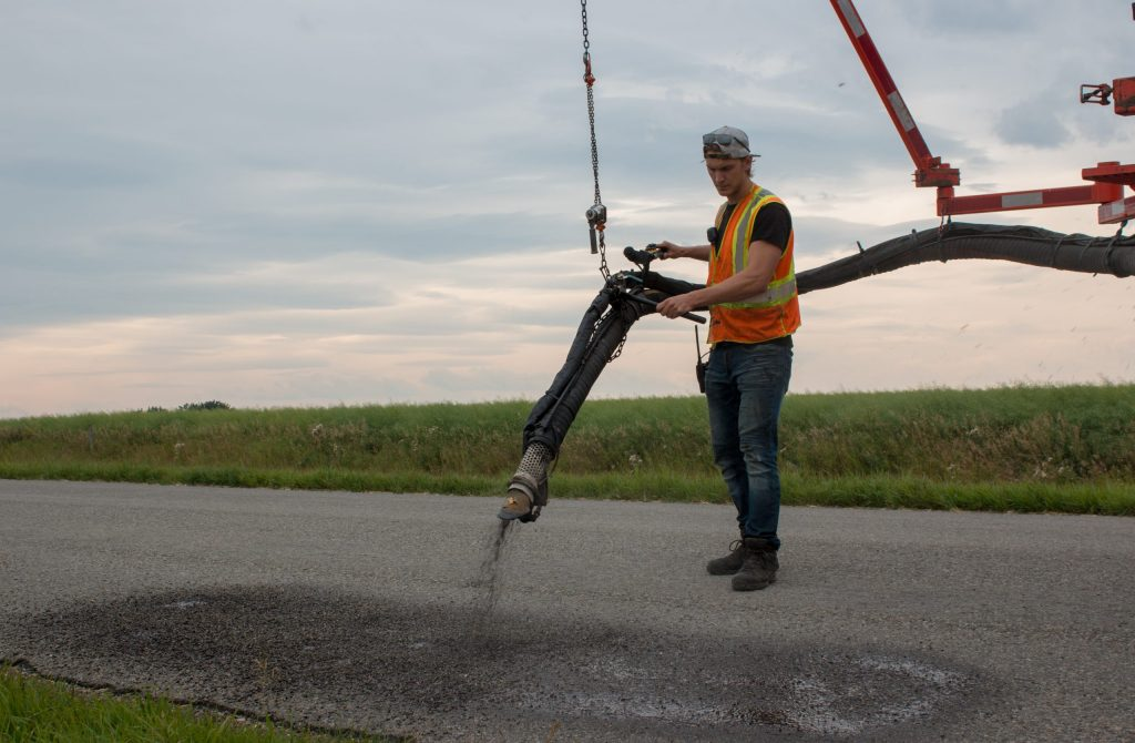spray patcher repairing asphalt in alberta